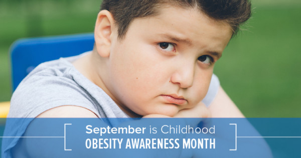 A young overweight boy looking unhappy shows that Childhood Obesity has reached Epidemic Proportions