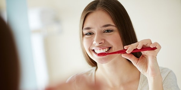 Change your brushing habits to get rid of tooth sensitivity