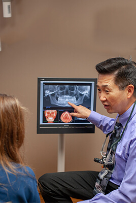 Shot of one of our doctors showing a patient an Xray