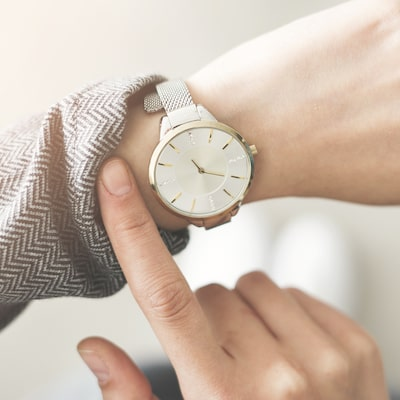 An arm with a watch secured on the wrist