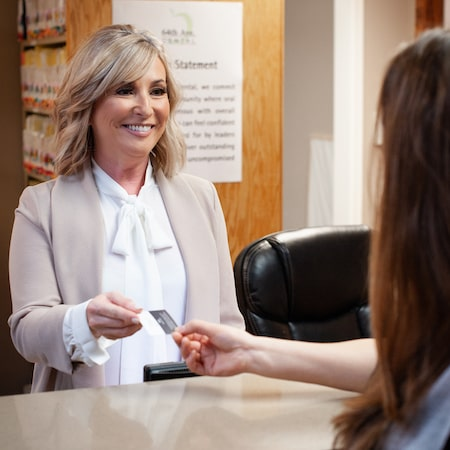 Sandy accepting card from a female patient